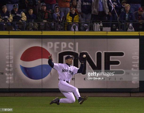 Right fielder Ichiro Suzuki of the Seattle Mariners makes a sliding catch during Game two of the American League Championship Series against the New...