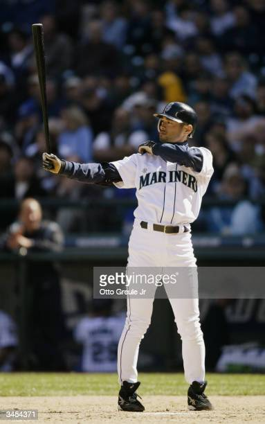 Right fielder Ichiro Suzuki of the Seattle Mariners pulls his sleeve during the game against the Anaheim Angels on April 8 2004 at Safeco Field in...