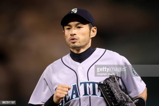 Right fielder Ichiro Suzuki of the Seattle Mariners runs off the field from his position in the game with the Los Angeles Angels of Anaheim on April...