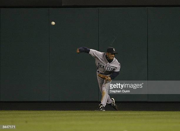 Right fielder Ichiro Suzuki of the Seattle Mariners throws the ball in during the game against the Anaheim Angels on April 13, 2004 at Angel Stadium...