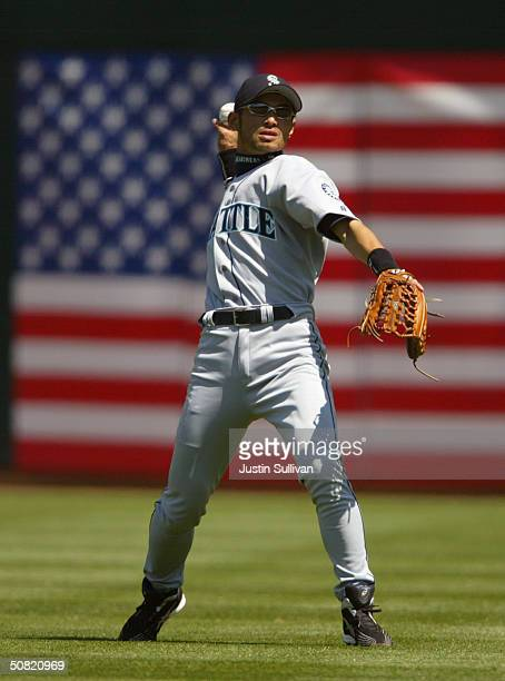 Right fielder Ichiro Suzuki of the Seattle Mariners throws the ball during the game against the Oakland Athletics at Network Associates Coliseum on...