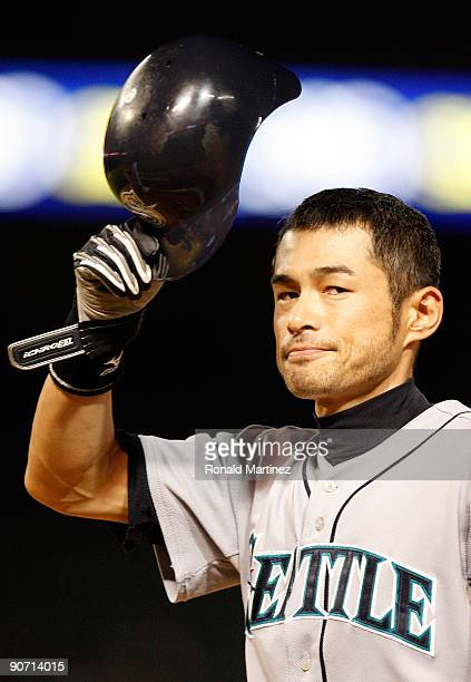Right fielder Ichiro Suzuki of the Seattle Mariners tips his helmet after hitting his 200 hit of the season against the Texas Rangers on September 13...