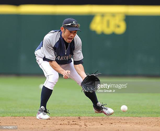 Right fielder Ichiro Suzuki of the Seattle Mariners tries his hand at shortstop during batting practice prior to the game against the Boston Red Sox...