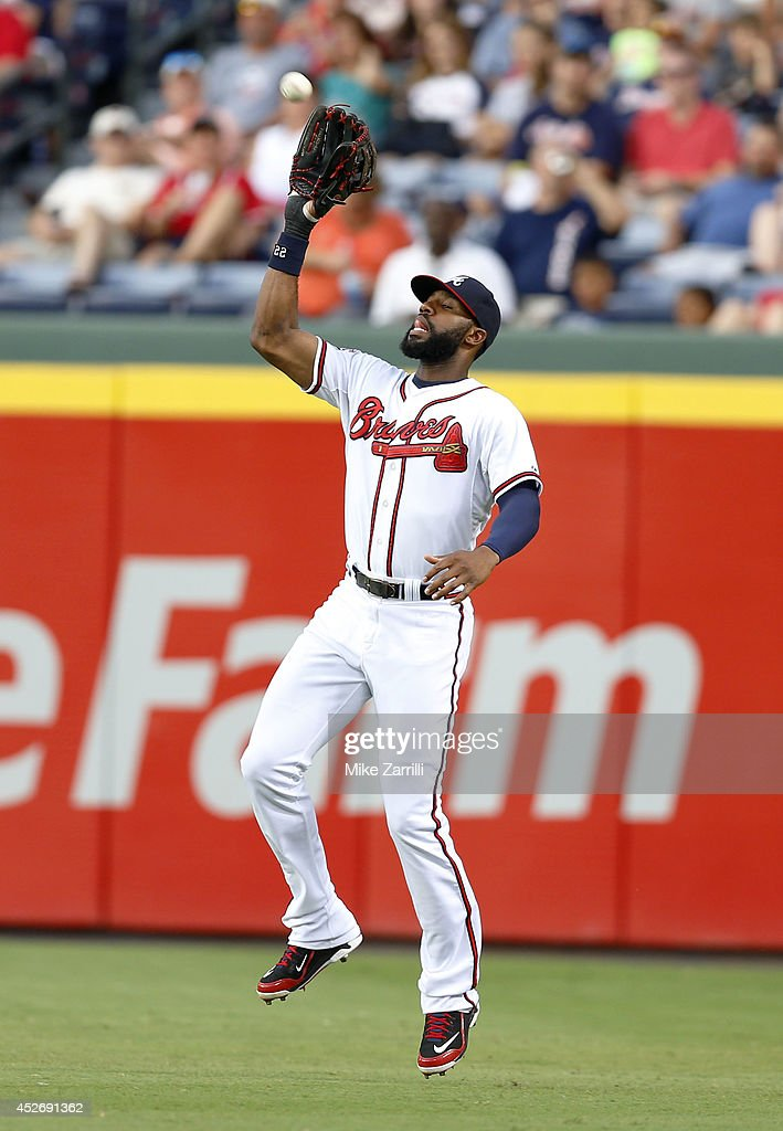 Right fielder Jason Heyward #22 of the Atlanta Braves catches a fly ball during the game against the San Diego Padres at Turner Field on July 25, 2014 in Atlanta, Georgia.