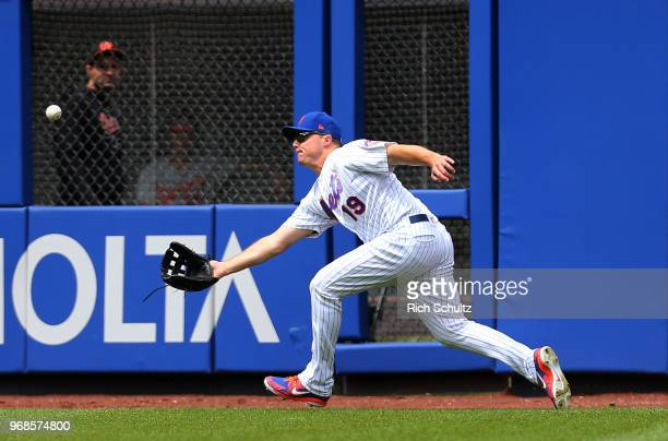 Right fielder Jay Bruce of the New York Mets makes a catch on a ball hit by Chris Davis of the Baltimore Orioles out during the seventh inning of a...