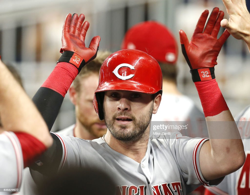 Right fielder Jesse Winker #33 of the Cincinnati Reds is congratulated in the dugout after his solo home run in the sixth inning during the game against the Atlanta Braves at SunTrust Park on August 18, 2017 in Atlanta, Georgia.