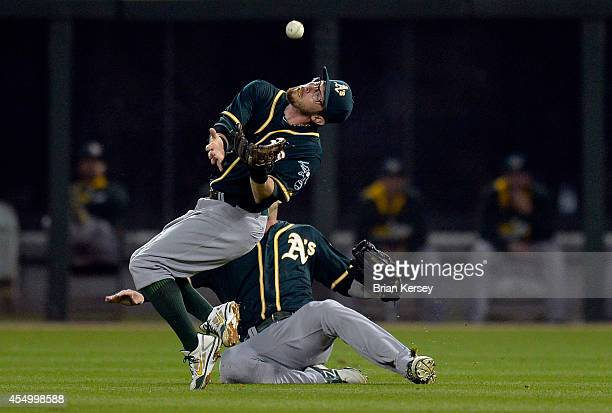 Right fielder Josh Reddick of the Oakland Athletics avoids second baseman Eric Sogard as he catches a pop-up hit by Andy Wilkins of the Chicago White...