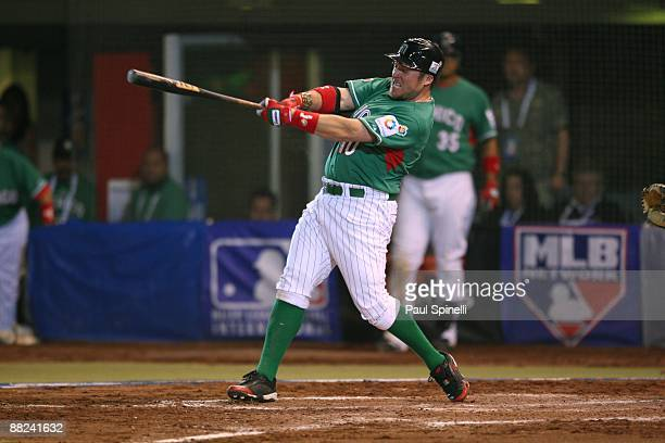 Right fielder Karim Garcia of Mexico hits a three run homer that proves to be the winning margin Australia in the Pool B game 5 in the first round of...