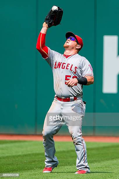 Right fielder Kole Calhoun of the Los Angeles Angels of Anaheim catches a fly ball hit by Michael Brantley of the Cleveland Indians to end the second...