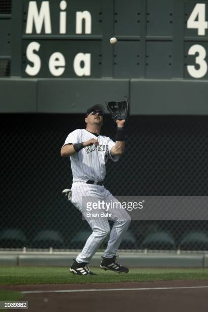 Right fielder Larry Walker of the Colorado Rockies catches a fly ball hit by Kurt Ainsworth of the San Francisco Giants during the sixth inning of...