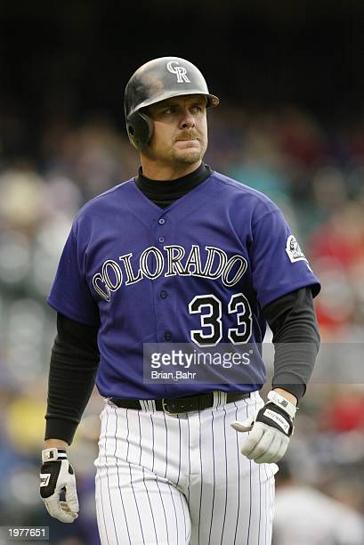 Right fielder Larry Walker of the Colorado Rockies walks to the dugout after he struck out swinging during the game against the Arizona Diamondbacks...