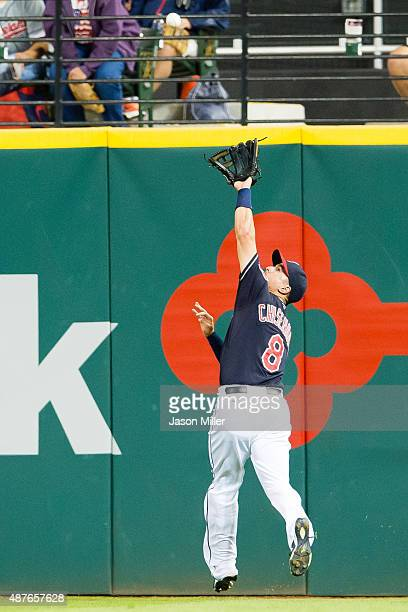 Right fielder Lonnie Chisenhall of the Cleveland Indians catches a fly ball off the bat of Victor Martinez of the Detroit Tigers during the fourth...