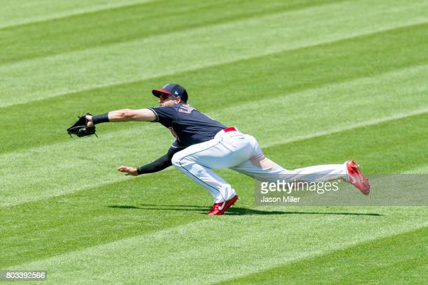 Right fielder Lonnie Chisenhall of the Cleveland Indians catches a fly ball hit by Joe Mauer of the Minnesota Twins to end the top of the sixth...