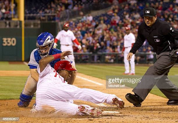 Right fielder Marlon Byrd of the Philadelphia Phillies is tagged out at home by catcher Josh Thole of the Toronto Blue Jays in the bottom of the...