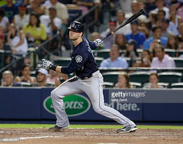 Right fielder Michael Saunders of the Seattle Mariners swings during the game against the Atlanta Braves at Turner Field on June 3 2014 in Atlanta...