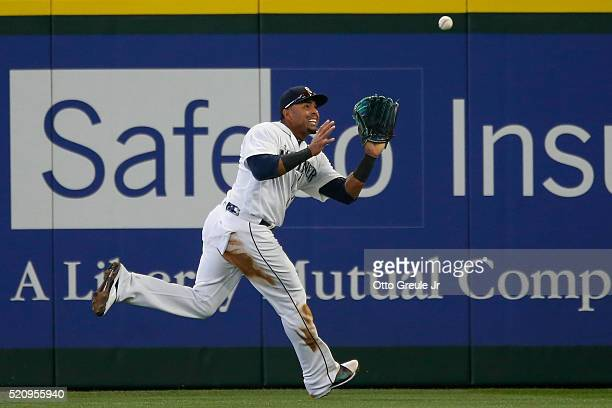 Right fielder Nelson Cruz of the Seattle Mariners catches a deep fly ball off the bat of Brett Nicholas of the Texas Rangers in the second inning at...