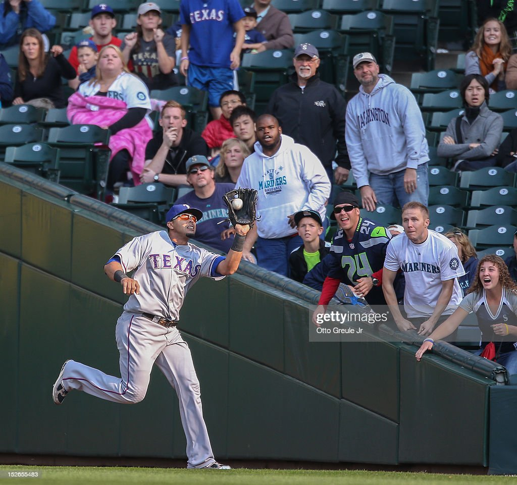 Right fielder Nelson Cruz #17 of the Texas Rangers catches a fly ball by Brendan Ryan of the Seattle Mariners for the second out of the ninth inning at Safeco Field on September 23, 2012 in Seattle, Washington. The Rangers defeated the Mariners 3-2.