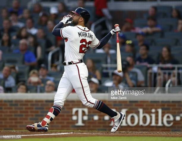 Right fielder Nick Markakis of the Atlanta Braves bats during the game against the Los Angeles Dodgers at SunTrust Park on July 26, 2018 in Atlanta,...
