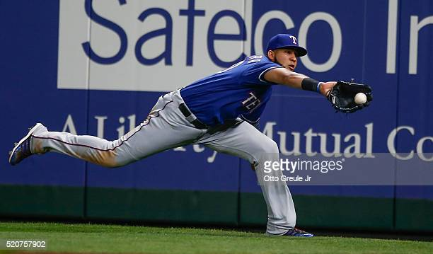 Right fielder Nomar Mazara of the Texas Rangers makes a diving catch on a ball off the bat of Chris Iannetta of the Seattle Mariners in the second...