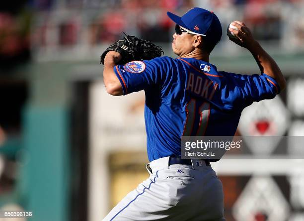 Right fielder Norichika Aoki of the New York Mets attempts to throw out Cesar Hernandez of the Philadelphia Phillies on a ball hit by Odubel Herrera...