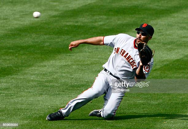 Right fielder Randy Winn of the San Francisco Giants catches a line drive by Russell Martin of the Los Angeles Dodgers in the sixth inning at Dodger...