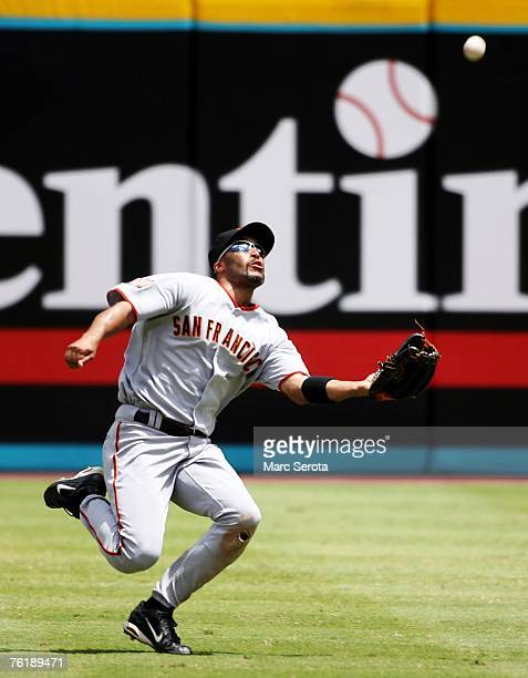 Right fielder Randy Winn of the San Francisco Giants makes a sliding catch in the fourth inning against the Florida Marlins at Dolphin Stadium on...