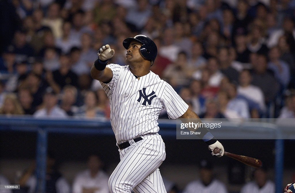 Right fielder Raul Mondesi #43 of the New York Yankees looks at the flight of the ball after hitting during game one of the American League Divisional Series against the Anaheim Angels at Yankee Stadium in the Bronx, New York on October 1, 2002. New York defeated the Angels 8-5 giving them a 1-0 lead in the best-of-five series.