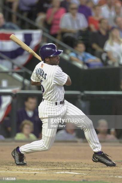 Right fielder Reggie Sanders of the Arizona Diamondbacks swings his bat during Game 1 of the National League Championship Series against the Atlanta...
