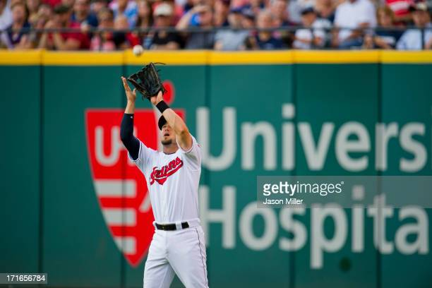 Right fielder Ryan Raburn of the Cleveland Indians catches a fly ball hit by Ryan Hanigan of the Cincinnati Reds during the third inning against the...
