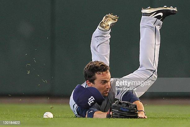 Right fielder Sam Fuld of the Tampa Bay Rays dives for and misses a single by Casper Wells of the Seattle Mariners at Safeco Field on July 31 2011 in...