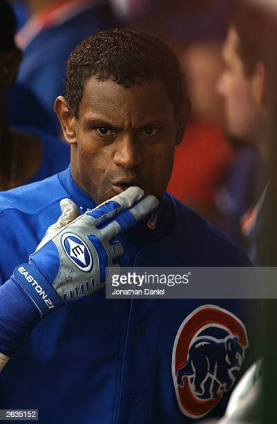 Right fielder Sammy Sosa of the Chicago Cubs blows kisses in the dugout after hitting a solo home run to center field against the Pittsburgh Pirates...