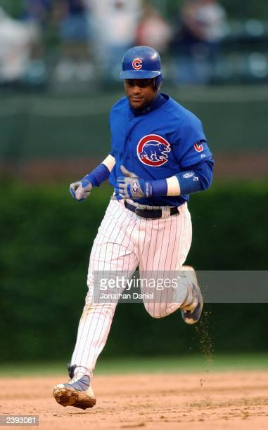 Right fielder Sammy Sosa of the Chicago Cubs rounds the bases after hitting a home run against the Arizona Diamondbacks during the MLB game at...