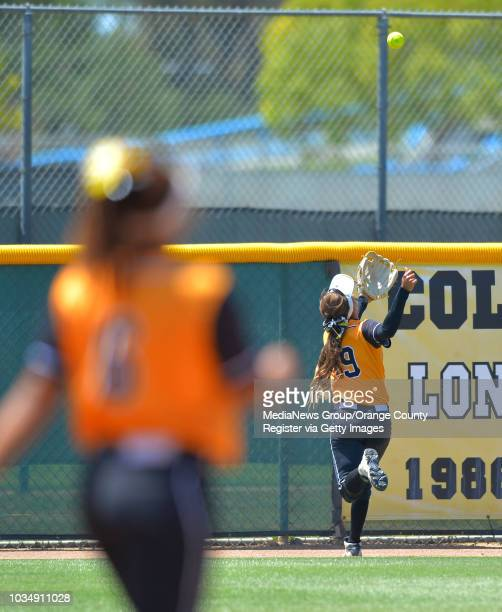 LBSU right fielder Sarah Carrasco is unable to catch a fly ball at the fence on an RBI triple hit by Cal Poly's Courtney Tyler as LBSU lost to Cal...