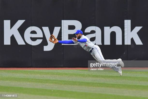 Right fielder Socrates Brito of the Toronto Blue Jays catches a fly ball hit by Tyler Naquin of the Cleveland Indians during the first inning at...