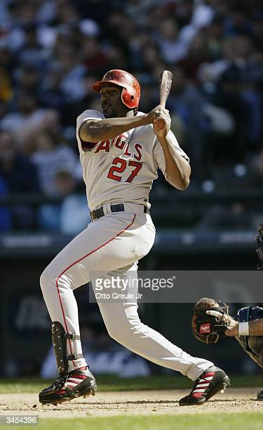 Right fielder Vladimir Guerrero of the Anaheim Angels swings during the game against the Seattle Mariners on April 8 2004 at Safeco Field in Seattle...
