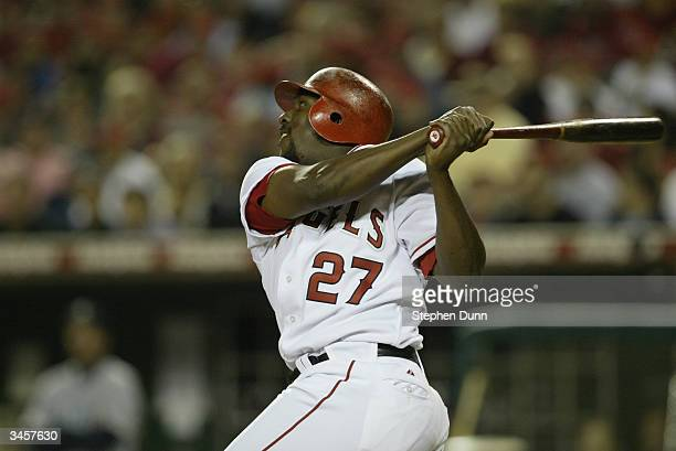 Right fielder Vladimir Guerrero of the Anaheim Angels swings during the game against the Seattle Mariners on April 14 2004 at Angel Stadium in...