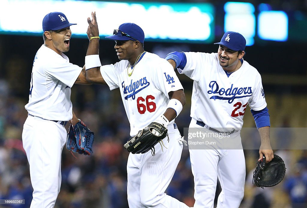 Right fielder Yasiel Puig #66 of the Los Angeles Dodgers celebrates with closer Brandon League #31 and first baseman Adrian Gonzalez #23 after the game with the San Diego Padres at Dodger Stadium on June 4, 2013 in Los Angeles, California. (Photo by Stephen Dunn/Getty Images) The Dodgers won 9-7.