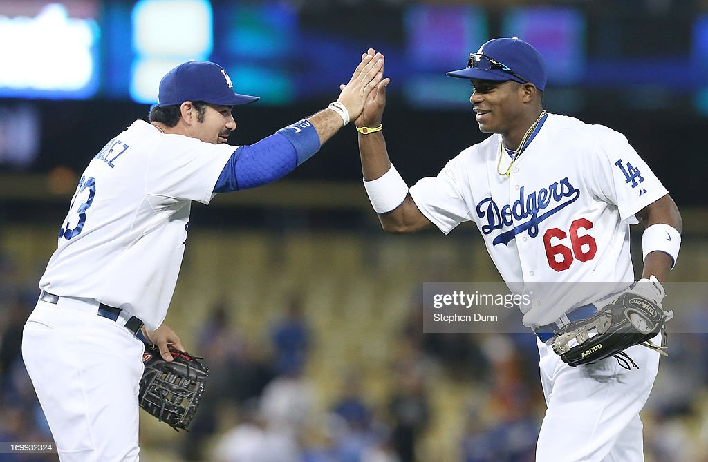 Right fielder Yasiel Puig #66 of the Los Angeles Dodgers celebrates with first baseman Adrian Gonzalez #23 after the game with the San Diego Padres at Dodger Stadium on June 4, 2013 in Los Angeles, California. (Photo by Stephen Dunn/Getty Images) The Dodgers won 9-7.