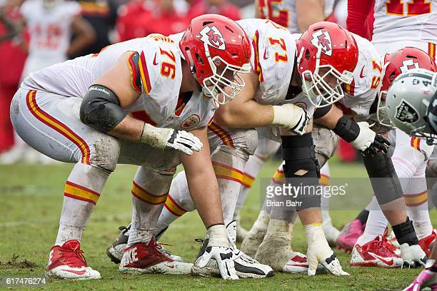 Right guard Laurent DuvernayTardif abd right tackle Mitchell Schwartz of the Kansas City Chiefs prepare for a snap against the Oakland Raiders in the...