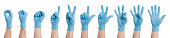 Right hand wearing latex surgical glove with gesture number from zero to five on white background. Multiple images. Collage