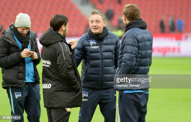 right Kevin Volland of Bayer 04 Leverkusen assistant coach Rainer Widmayer and Niklas Stark of Hertha BSC before the first Bundeliga game between...