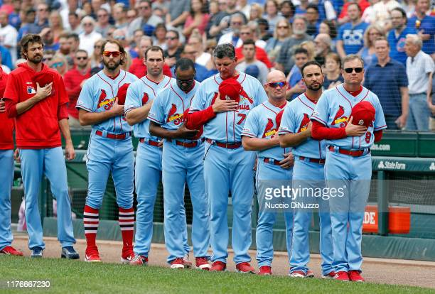 Right manager Mike Shildt of the St Louis Cardinals stands with his team for the nation l anthem prior to a game against the Chicago Cubs at Wrigley...