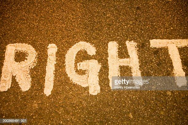 """""""right"""" painted on street - henry street stock pictures, royalty-free photos & images"""
