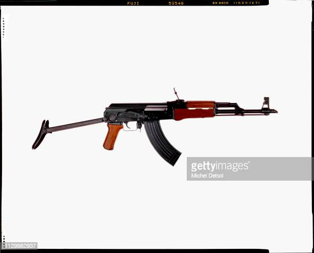 Right profile of an AKM assault rifle with an attached magazine seen against a white background New York New York March 9 1994 The photo was taken as...