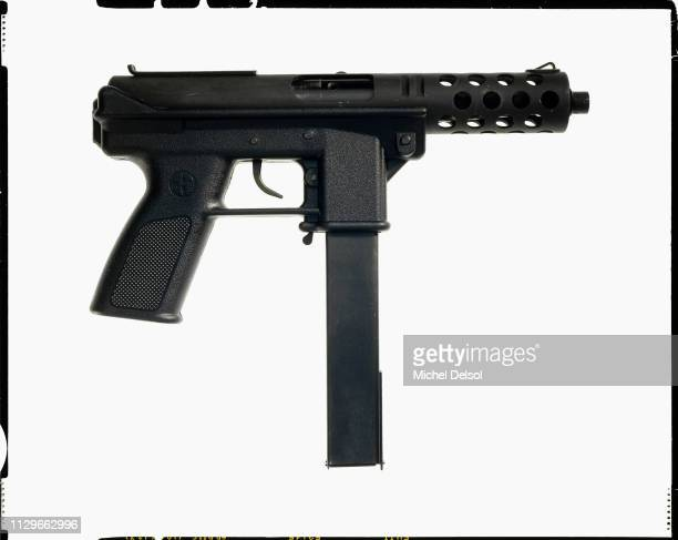 Right profile of an Intratec TEC9 semiautomatic pistol with an attached magazine seen against a white background New York New York March 9 1994 The...