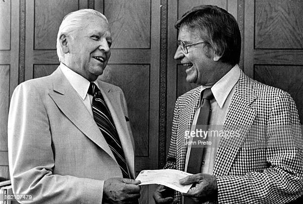 JUL 7 1980 JUL 8 1980 Right to Left Owen F Murphy APR for Chevron presenting check to Francis Van Derbur