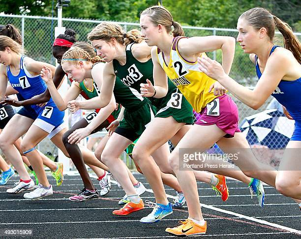 Right to left race winner Erzsebet Nagy of Lawrence High School fourthplace finisher Charlotte Pierce of Thornton Academy High School thirdplace...