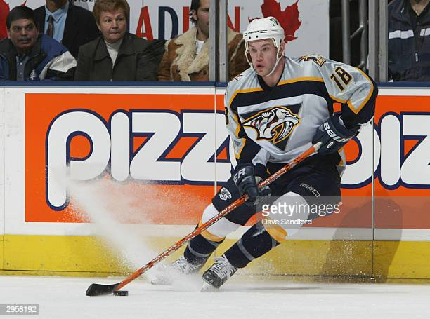 Right wing Adam Hall of the Nashville Predators controls the puck during the game against the Toronto Maple Leafs at Air Canada Center on January 6...