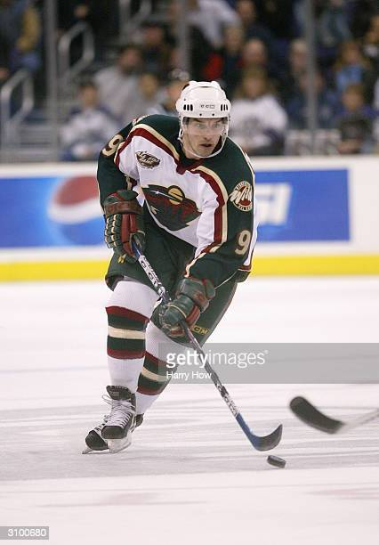 Right wing Alexandre Daigle of the Minnesota Wild moves the puck during the game against the Los Angeles Kings on January 26 2004 at the Staples...
