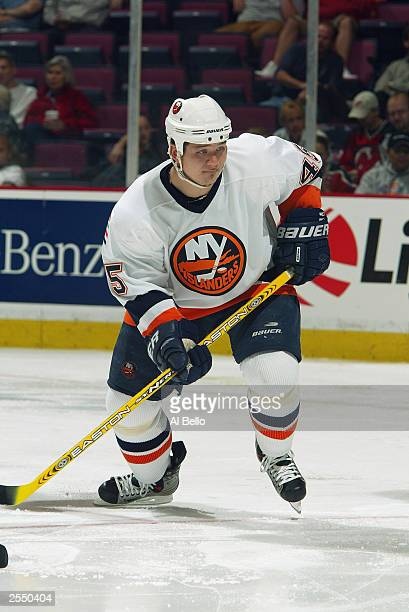 Right wing Arron Asham of the New York Islanders pushes off an edge during a game against the New Jersey Devils on September 24 2003 at the...